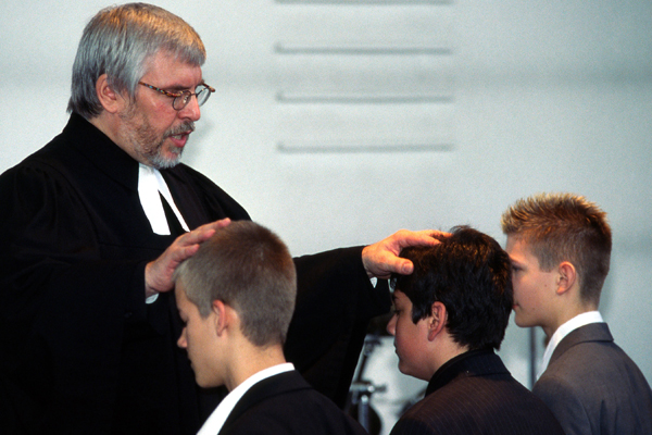 Young people receive pastoral care in the form of companionship, prayer and blessing.